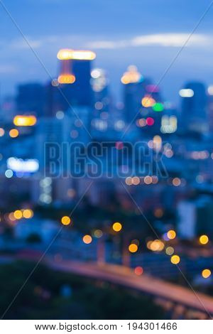 Twilight blurred bokeh light office building downtown cityscape abstract background