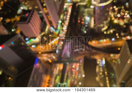 Top view City intersection road blurred bokeh light night view abstract background