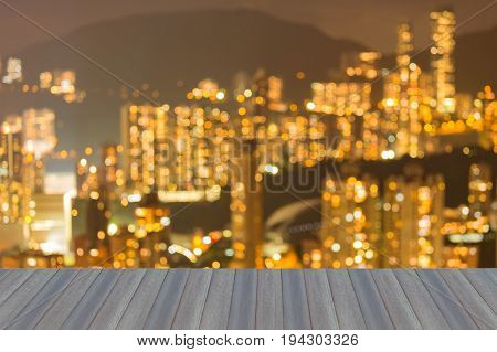 Blurred bokeh light Hong Kong residence apartment on high hill abstract background night view