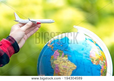 Tourist holding airplane flight travel traveller fly travelling citizenship air on the around world. Travel Concept.