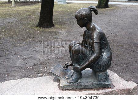 St. Petersburg, Russia - March 25, 2017: Sculpture. Schoolgirl artist. Alexander Park near the Peter and Paul Fortress in March 25 in St. Petersburg, Russia