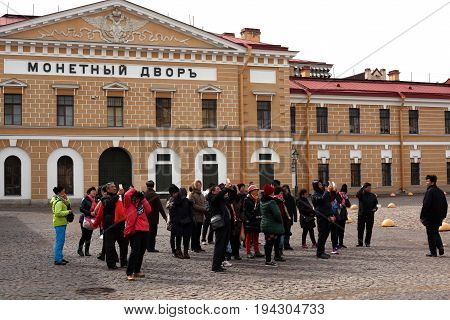 St. Petersburg, Russia - March 25, 2017: Chinese tourists take pictures in Peter and Paul Fortress, Saint Petersburg Mint. Museum in historic center. tourist sighting  in St. Petersburg, Russia