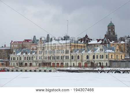 The old building of the cargo port administration in the gloomy February day. Vyborg, Russia