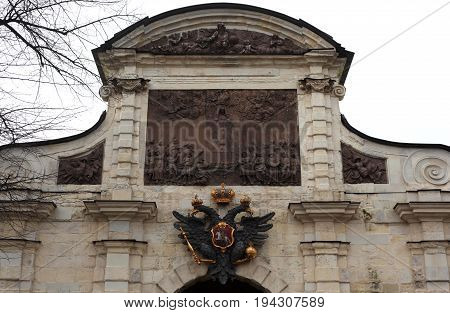 St. Petersburg, Russia - March 25, 2017:  The Peter's Gate. Coat of arms of Russian Empire Peter and Paul Fortress. Museum in historic center. tourist sighting in March 25 in St. Petersburg, Russia