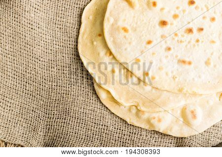 Flat Bread On A Burlap Background
