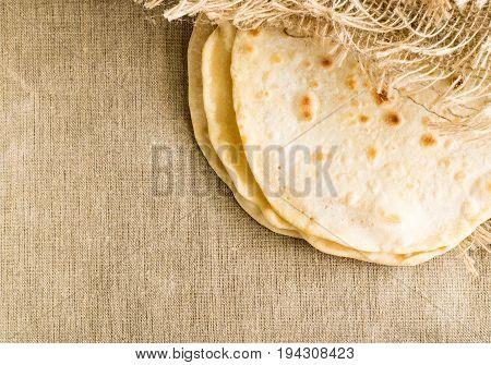 Flat Bread On A Burlap Background