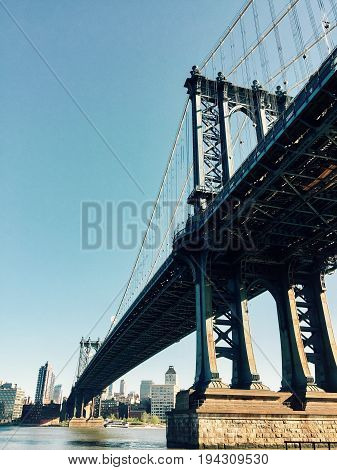 Manhattan bridge over East river and Brooklyn in faded vintage style