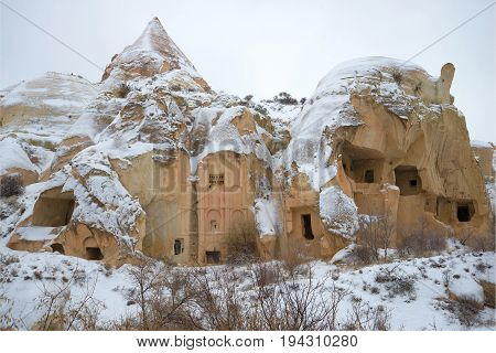 The ruins of ancient Christian church in the Pink Valley on a gloomy January day. Cappadocia, Turkey