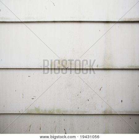 Grungy white house siding panel texture