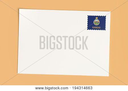 Letter Or Postcard From US States: Blank White Card with Kansas Flag Postage Stamp 3d Illustration On Wooden Color
