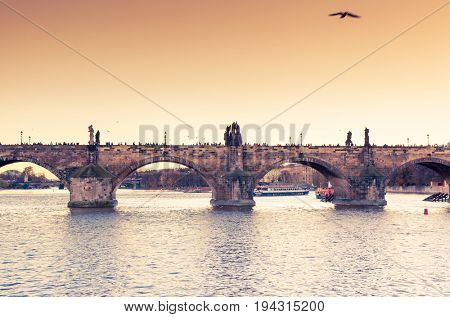 Stunning image of Charles bridge (Karluv Most) and lesser town bridge tower on river Vltava. Location place Prague, Czech Republic, sightseeing Europe. Popular tourist attraction. Beauty world.