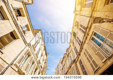 Street view from below on the beautiful buildings and blue sky in Nantes city in France