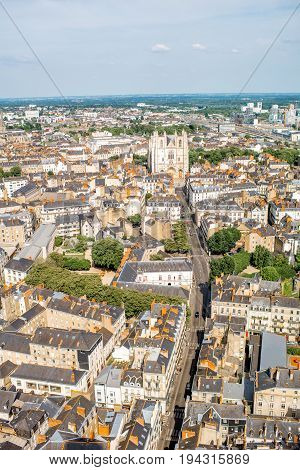 Aerial cityscape view with beautiful buildings and cathedrals in Nantes city during the sunny weather in France