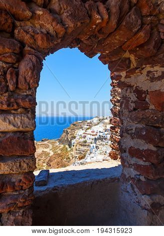 Byzantine Castle Ruins in Oia village, Santorini, Greece, early in the morning, panoramic image.