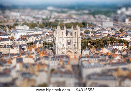 Aerial cityscape view with beautiful buildings and saint Pierre cathedral in Nantes city during the sunny weather in France. Tilt shift image technic