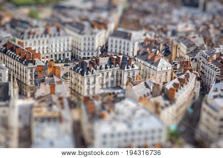 Aerial cityscape view with beautiful old buildings in Nantes city during the sunny weather in France. Tilt shift image technic