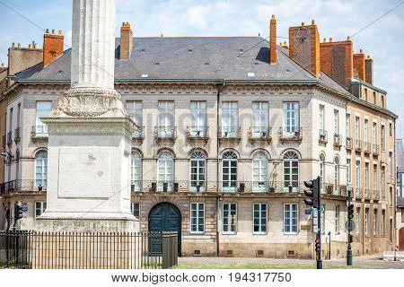 Street view on the Marechal-Foch sqaure with Louis column during the sunny morning in Nantes city in France
