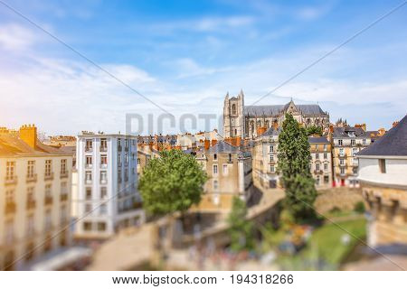 Beautiful cityscape view with saint Pierre cathedral and castle walls in Nantes city during the sunny day in France
