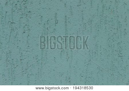 Blue Putty On The Wall Is Depicted
