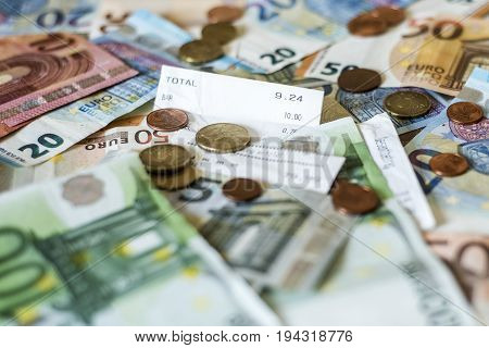 savings Cash money concept euro banknotes of all sizes and cent coins on desk bill pay store text sum total save