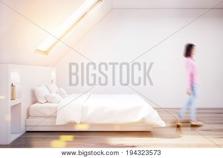 Woman in a white attic bedroom with a wooden floor a narrow window a white bed with bedside tables. Side view. 3d rendering mock up toned image