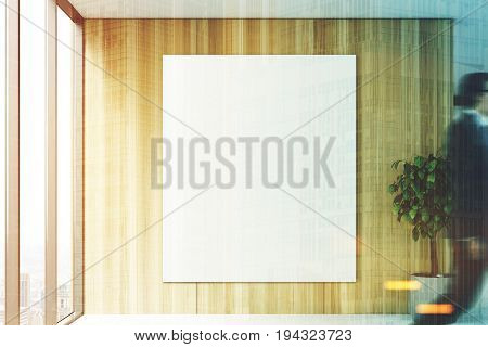 Blank vertical poster is hanging on a wooden wall of an office lobby. There is a panoramic window and a tree in a pot. People. 3d rendering mock up toned image double exposure