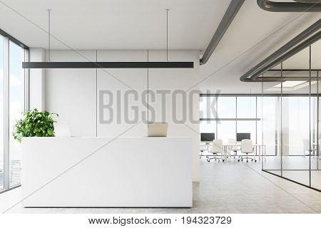 White office interior with a reception desk standing near a loft window in an office lobby with glass walls and a meeting room. 3d rendering mock up