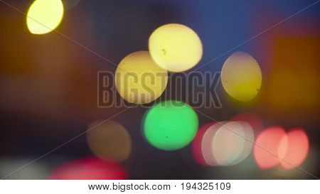 Defocused traffic lights at night in Moscow. 4K. Out of focus