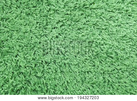 Fabric Texture Close Up of Green Plush Texture Pattern Background with Copy Space for Text Decoration.