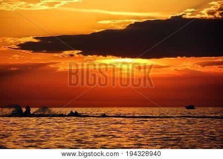 PULA/CROATIA - 7 JULY 2017: Tourists riding a ski jet at sunset in Pula, southern Istria