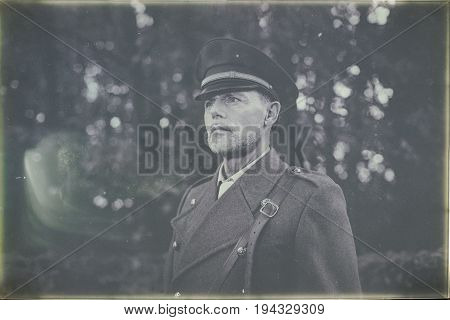 Antique Black And White Photo Of 1940S Military Officer Standing In Autumn Forest.