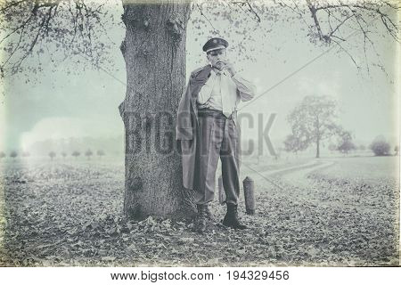 Antique Black And White Photo Of 1940S Military Officer With Coat Over Shoulder Smoking Cigarette Un