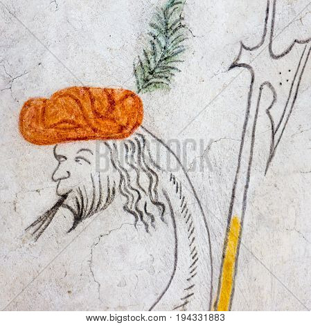 Fantasy bird with an human head holding a halberd medieval fresco medieval gothic fresco in Vinderslev church Denmark June 22 2017