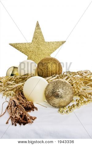 Christmas Decorations On A Table Wiyh White Cloth