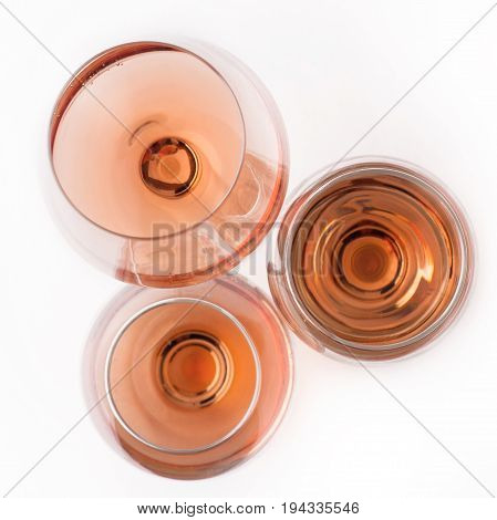 top view of three rose wine glasses of different shapes and sizes isolated on white background
