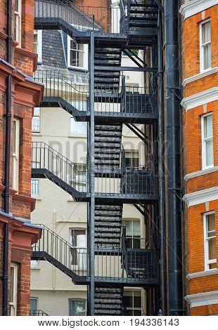 London, UK - September 8, 2016: Fire stairs in residential block, Kensington