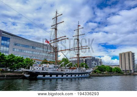 Cardiff Bay Wales - May 21 2017: Stavros S Niarchos Tall Ship Training ship moored near the barrage at Cardiff Bay side view.
