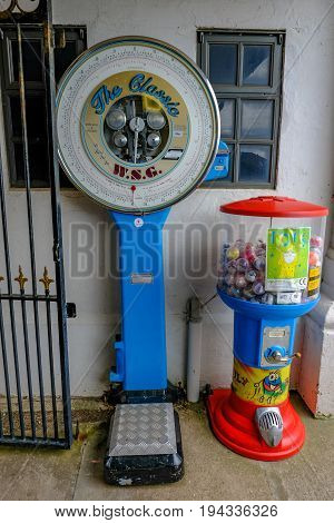 Penarth Wales - May 21 2017: WSG coin operated weighing machine on Penarth Pier standing by the wall.