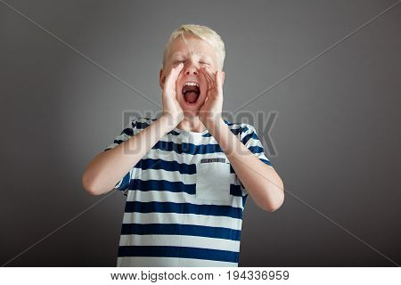 Shouting Teen With Hands Placed Around His Face