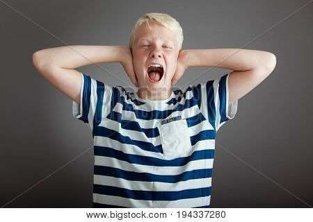 Screaming Blond Teen With Hands Covering Ears