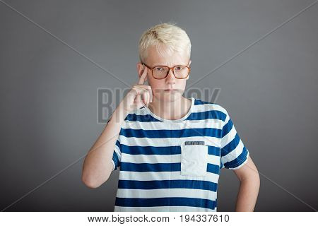Blond Teen In Striped Shirt Pointing To Head