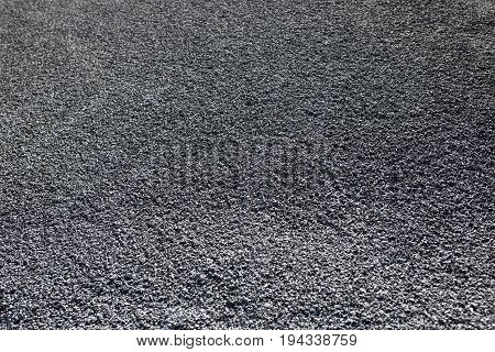 Asphalt from a carpark. This is completely newly laid and not yet driven on.