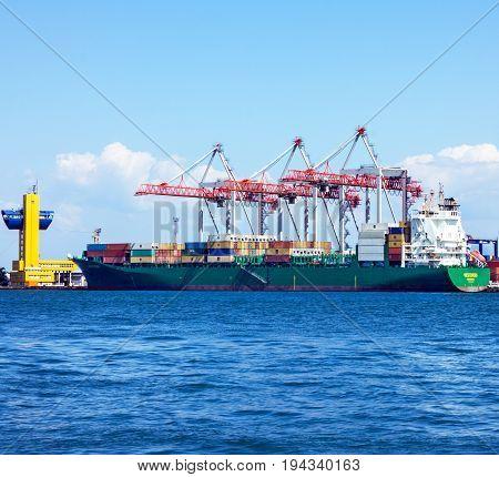ODESSA, UKRAINE - MAY 7, 2017: Cargo ship in container terminal Odessa sea port