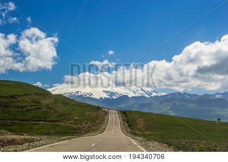 High Mount Elbrus, beautiful view of snow tops, mountain panorama, sights and mountains of the North Caucasus, trailering, mountain road