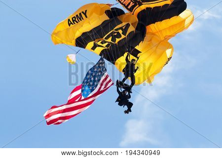Wantagh NY United States - 26 May 2017: US Army paratroopers carying the american flag open up the practice show for the air show that was to be held the next two days during memorial day weekend at Jones Beach NY.