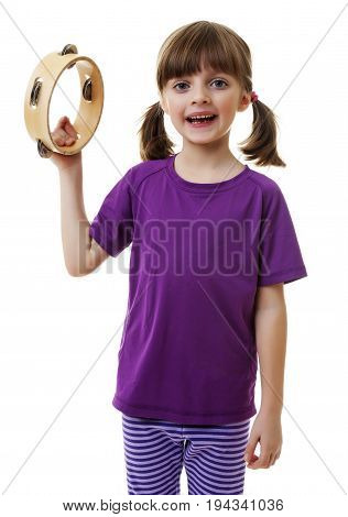 little girl playing and singing - tambourine