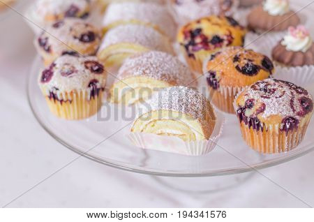 colorful small different cake collection on the plate