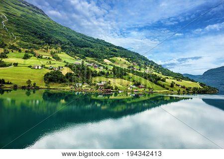 Norway, Olden green hills seaside. fjord in summer.