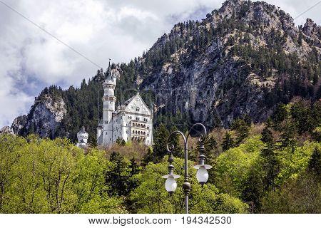 Palace in Bavaria, Germany. Castle Neuschwanstein mountain view