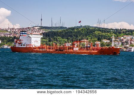 Istanbul, Turkey - May 4, 2017: Cargo vessel and Istanbul seafront, Turkey.